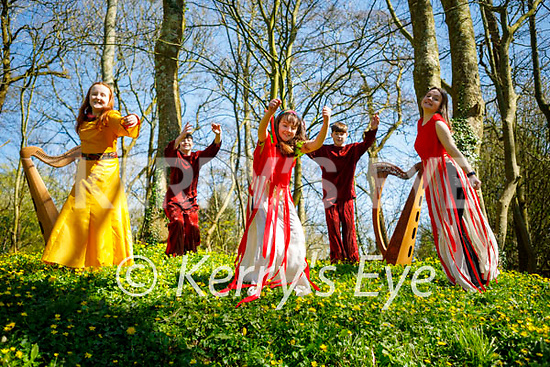 Jumping for joy at the launch of Siamsa Tire's Litha (Summer Solstice) event which will be part of the Youth Arts Festival in the Europe Gardens in the Listowel town park on Friday. L to r: Grace Walsh, Dáibhéid O'Regan, Mary Walsh, Dáibhéid and Tara O'Regan