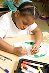 Education Elementary Grade 2 girl at work drawing with markers