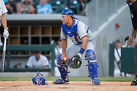 Durham Bulls catcher Luke Maile (26) picks up the baseball as home plate umpire Jansen Visconti looks on during the game against the Charlotte Knights at BB&T BallPark on July 22, 2015 in Charlotte, North Carolina.  The Knights defeated the Bulls 6-4.  (Brian Westerholt/Four Seam Images)