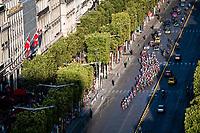 peloton rolling down the Champs-Elysées at sunset<br /> <br /> Stage 21: Rambouillet to Paris (128km)<br /> 106th Tour de France 2019 (2.UWT)<br /> <br /> ©kramon