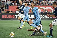 FOXBOROUGH, MA - SEPTEMBER 29: Heber #9 of New York City FC tripped up in a tackle during a game between New York City FC and New England Revolution at Gillettes Stadium on September 29, 2019 in Foxborough, Massachusetts.