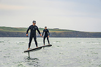 BNPS.co.uk (01202 558833)<br /> Pic: TigerCo/Fliteboard/BNPS<br /> <br /> WITH VIDEO... https://youtu.be/g3GtthQhkNI<br /> <br /> Pictured: Rob Wylie, 51, and his 19-year-old son Morgan (left)<br /> <br /> A father and son have become the first people to cross the English Channel non-stop on an eFoil board.<br /> <br /> Rob Wylie, 51, and his 19-year-old son Morgan are now world record holders after completing the 23 mile crossing in one hour and 44 minutes.<br /> <br /> They completed their mission on Fliteboards, electric-powered hydrofoil boards that hover above the water.<br /> <br /> They managed to do it on one battery charge although Rob had just four per cent battery left when they reached the shore in Folkestone, Kent.