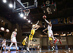SIOUX FALLS, SD - MARCH 8: Stanley Umude #0 of the South Dakota Coyotes goes for a layup against Grant Nelson #4 of the North Dakota State Bison during the Summit League Basketball Tournament at the Sanford Pentagon in Sioux Falls, SD. (Photo by Richard Carlson/Inertia)
