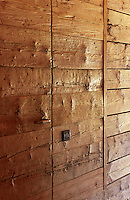 Rough planking lines the walls of the chalet adding texture to the design of its interior