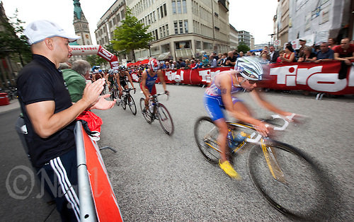 17 JUL 2011 - HAMBURG, GER - Emmie Charayron (FRA) leads a pack through the streets of Hamburg during the women's round of triathlon's ITU World Championship Series .(PHOTO (C) NIGEL FARROW)