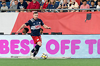 FOXBOROUGH, MA - SEPTEMBER 11: Tommy McNamara #26 of New England Revolution dribbles down the wing during a game between New York City FC and New England Revolution at Gillette Stadium on September 11, 2021 in Foxborough, Massachusetts.