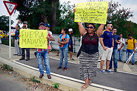 CÚCUTA- COLOMBIA, 07-02-2019:Ciudadanas y ciudadanos de Venezuela protestan contra el régimen de Nicolás Maduro durante la  llegada de camiones con la ayuda humantaria para el pueblo venezolano  al Puente de Tienditas frontera con Venezuela ./ Citizens  of Venezuela protest against the regime of Nicolás Maduro during the arrival of trucks with humanitarian aid for the Venezuelan people to the Bridge of Tienditas, border with Venezuela . Photo: VizzorImage / Manuel Hernández  / Contribuidor