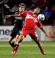 Chicago Fire defender Wilman Conde (22) shields the ball from DC United forward Jaime Moreno (99). The Chicago Fire defeated D. C. United 1-0 during the first leg of the MLS Eastern Conference Semifinal Series at Toyota Park in Bridgeview, IL, on October 25, 2007.