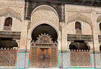 Fes, Morocco.  Medersa Bou Inania.  Woodwork and Stucco Decoration around the inner Courtyard.
