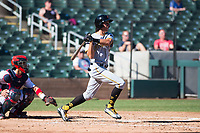 Surprise Saguaros shortstop Cole Tucker (2), of the Pittsburgh Pirates organization, follows through on his swing in front of catcher Tres Barrera (12) during an Arizona Fall League game against the Salt River Rafters at Salt River Fields at Talking Stick on November 5, 2018 in Scottsdale, Arizona. Salt River defeated Surprise 4-3 . (Zachary Lucy/Four Seam Images)
