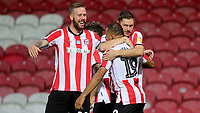 Pontus Jansson and Henrik Dalsgaard congratulate Bryan Mbeumo after scoring Brentford's third goal during Brentford vs Swansea City, Sky Bet EFL Championship Play-Off Semi-Final 2nd Leg Football at Griffin Park on 29th July 2020
