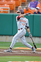 Florida State Seminoles shortstop Justin Gonzalez #10 swings at a pitch during a game against the Clemson Tigers at Doug Kingsmore Stadium on March 22, 2014 in Clemson, South Carolina. The Seminoles defeated the Tigers 4-3. (Tony Farlow/Four Seam Images)