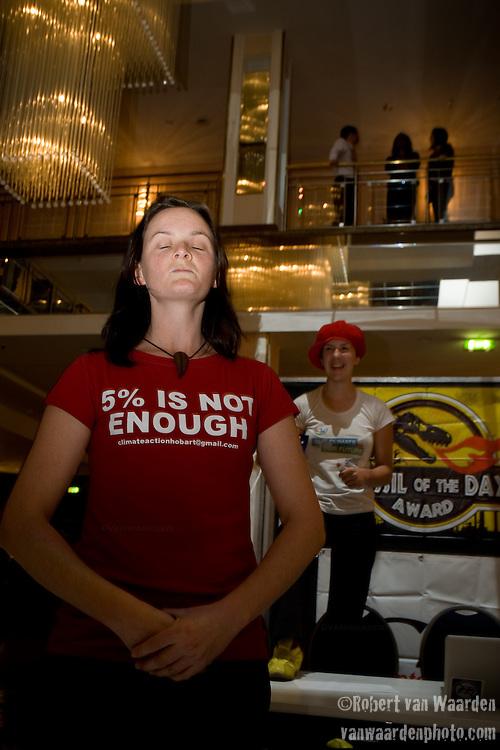Gemma Tillick from Australia accepts the first prize fossil award on behalf of Australia. United Nations Climate Talks in Bonn Germany (©Robert vanWaarden)