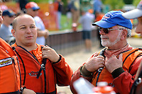 Tom Johnson (R) talks with son-in-law Brian Trollian between heats.