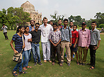 8 October 2013, New Delhi, India. Recently retired Australian cricket star Brett Lee poses with local cricket fans after a scratch game of tennis ball cricket in front of a Mughal era tomb in the famous Lodi Gardens in New Delhi. His arrival caused great interest in the local boys in the grounds. He is in India to show off his latest fashion lines and to foster greater interest in Australian - Indian business interactions.  Picture by Graham Crouch