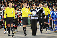 MLS referee Mark Geiger taking the game ball.  Sporting Kansas City defeated D.C. United  1-0 at RFK Stadium, Saturday March 10, 2012.