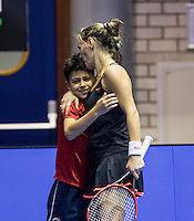 Rotterdam, Netherlands, December 14, 2016, Topsportcentrum, Lotto NK Tennis, Olga Kalyuzhnaya (NED)  Kissing her son after her match where he is ballboy<br /> Photo: Tennisimages/Henk Koster