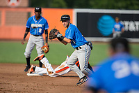 Hudson Valley Renegades shortstop Deion Tansel (9) looks to make a throw to first base after having tagged out Jaylen Ferguson (18) of the Aberdeen IronBirds at Leidos Field at Ripken Stadium on July 27, 2017 in Aberdeen, Maryland.  The Renegades defeated the IronBirds 2-0 in game one of a double-header.  (Brian Westerholt/Four Seam Images)