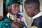 Jockey James Mahindi pinning the jersey of Waycliff Matee before The Kenya Derby.