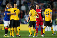 SYDNEY, AUSTRALIA - JULY 31, 2010: Players shake hands after the match between AEK Athens FC and Glasgow Rangers at the 2010 Sydney Festival of Football held at the Sydney Football Stadium on July 31, 2010 in Sydney, Australia. (Photo by Sydney Low / www.syd-low.com)