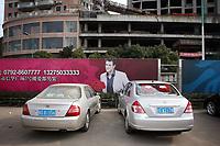 CHINA. Jiangxi Province. Jiujiang. An advertisement in a parking lot.  Jiujiang is a city of 4.6 million people, located on the southern shore of the Yangtze River.  2008