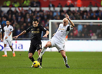 Wednesday, 01 January 2014<br /> Pictured: Jonjo Shelvey of Swansea (R) againstJesus Navas (L) of Manchester City<br /> Re: Barclay's Premier League, Swansea City FC v Manchester City at the Liberty Stadium, south Wales.