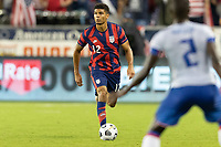 KANSAS CITY, KS - JULY 11: Miles Robinson #12 of the United States moves with the ball during a game between Haiti and USMNT at Children's Mercy Park on July 11, 2021 in Kansas City, Kansas.