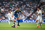 Real Madrid's player James Rodriguez and Alvaro Morata and Celta de Vigo's player Gustavo Daniel Cabral during a match of La Liga Santander at Santiago Bernabeu Stadium in Madrid. August 27, Spain. 2016. (ALTERPHOTOS/BorjaB.Hojas)