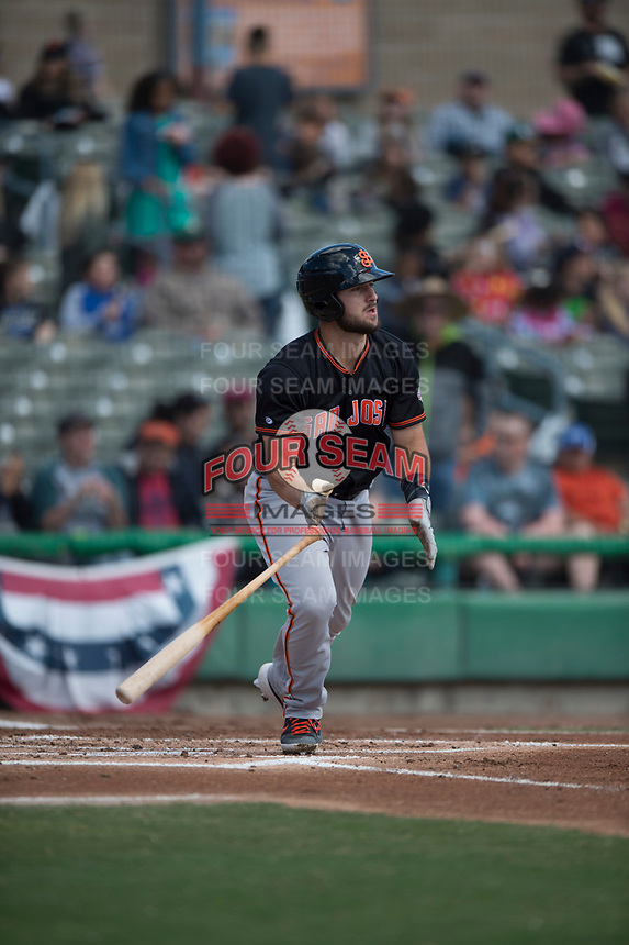 San Jose Giants catcher Joey Bart (9) hits a double during a California League game against the Stockton Ports on April 9, 2019 in Stockton, California. San Jose defeated Stockton 4-3. (Zachary Lucy/Four Seam Images)