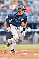 Columbia Fireflies shortstop J.C. Rodriguez (13) runs to first base during a game against the Asheville Tourists at McCormick Field on August 17, 2016 in Asheville, North Carolina. The Tourists defeated the Fireflies 7-6. (Tony Farlow/Four Seam Images)