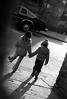 Montreal (Qc) Canada - File Photo-  1985 - Two Kids  walk holding hands in Saint-Henri poor area of Montreal