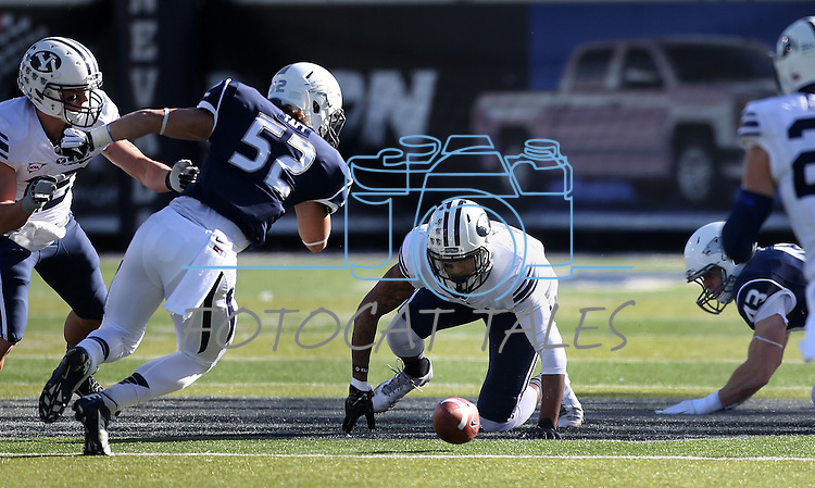 BYU's Cody Hoffman (2), center, and Nevada's Trevor Taft (52) scramble to recover a fumble during the first half an NCAA college football game in Reno, Nev., on Saturday, Nov. 30, 2013. (AP Photo/Cathleen Allison)