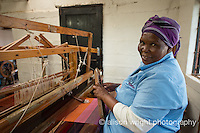 Africa, Swaziland, Malkerns.Nest organization artisan project, partnering with Rosecraft weaving  & local artisans to help market their products to global markets and better sustain their local community. Anna Sihlongonyane weaving at her loom.