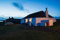 Thatched roof traditional blackhouse now used as youth hostel, Berneray, Outer Hebrides, Scotland