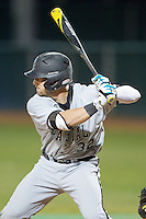 Tyler Chadwick (32) of the Coastal Carolina Chanticleers at bat against the High Point Panthers at Willard Stadium on March 14, 2014 in High Point, North Carolina.  The Panthers defeated the Chanticleers 3-0.  (Brian Westerholt/Four Seam Images)