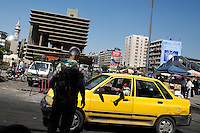 A man shows his ID to a soldier at a military checkpoint in the centre of Damascus, Syria. Checkpoints have become a fact of daily life in the Syrian capital as suicide bombers and car bombs have continually targeted all areas of the city.