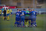 Glossop North End 0 Barnoldswick Town 1, 19/02/2011. Surrey Street, North West Counties League Premier Division. The Glossop North End players gathering in a huddle before their club's game with Barnoldswick Town in the Vodkat North West Counties League premier division at the Surrey Street ground. The visitors won the match by one goal to nil watched by a crowd of 203 spectators. Glossop North End celebrated their 125th anniversary in 2011 and were once members of the Football League in England, spending one season in the top division in 1899-00. Photo by Colin McPherson.