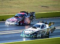 Sept. 23, 2012; Ennis, TX, USA: NHRA funny car driver Mike Neff (near lane) races alongside Tony Pedregon during the Fall Nationals at the Texas Motorplex. Mandatory Credit: Mark J. Rebilas-US PRESSWIRE