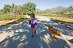 Chinese-American girl with her golden retreiver on a walk