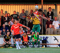 Steve O'Donnell of Luton Town wins the aerial battle during the Friendly match between Hitchin Town and Luton Town at Top Field, Hitchin, United Kingdom on 16 July 2015. Photo by Liam Smith.