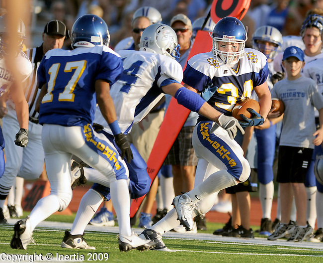 SIOUX FALLS, SD - SEPTEMBER 18:  Miles McLaughlin #34 of O'Gorman outruns Rapid City Stevens defenders in the second half Friday evening. The Knights defeated the Raiders 13-6 at McEneaney Field in Sioux Falls. (Photo by Craig Johnson/Inertia)