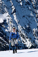 Man climbing in snow in mountains, Mount Dickerman, Snohomish County, Washington, USA