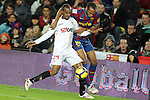 Football Season 2009-2010. Barcelona's player Thierry Hernry (R) and Sevilla's  Konko (L) during their spanish liga soccer match at Camp Nou stadium in Barcelona. January 16, 2010.