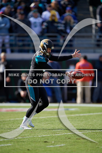 Jacksonville Jaguars Brad Nortman (3) punts during an NFL Wild-Card football game against the Buffalo Bills, Sunday, January 7, 2018, in Jacksonville, Fla.  (Mike Janes Photography)