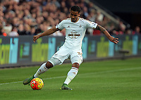 Kyle Naughton of Swansea crosses the ball during the Barclays Premier League match between Swansea City and Arsenal at the Liberty Stadium, Swansea on October 31st 2015