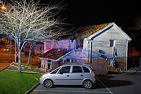 Pictured: The damaged building in the Waunceirch area of Neath, Wales, UK. Monday 14 January 2018<br /> Re: Four flats have been evacuated after an explosion in Neath at 8:30pm on Monday.<br /> Extensive damage was caused to Waun Las, in the Waunceirch area and arrangements made to house its residents until the building is deemed safe.<br /> One woman was taken to hospital with serious burn injuries which are not believed to be life threatening.<br /> A joint investigation is under way between South Wales Police and the fire service to determine the cause.<br /> Wales and West Utilities said the gas supply to the affected property had been isolated.