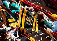 5th June 2021; Brentford Community Stadium, London, England; Gallagher Premiership Rugby, London Irish versus Wasps; Wasps fan waving Wasps flags