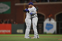 SAN FRANCISCO, CA - OCTOBER 9:  Justin Turner #10 and Cody Bellinger #35 of the Los Angeles Dodgers celebrate after Game 2 of the NLDS against the San Francisco Giants at Oracle Park on Saturday, October 9, 2021 in San Francisco, California. (Photo by Brad Mangin)