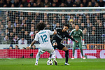 Neymar da Silva Santos Junior, Neymar Jr (R), of Paris Saint Germain competes for the ball with Marcelo Vieira Da Silva of Real Madrid during the UEFA Champions League 2017-18 Round of 16 (1st leg) match between Real Madrid vs Paris Saint Germain at Estadio Santiago Bernabeu on February 14 2018 in Madrid, Spain. Photo by Diego Souto / Power Sport Images