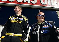 Nov. 11, 2012; Pomona, CA, USA: NHRA top fuel dragster driver Morgan Lucas (left) with teammate Brandon Bernstein during the Auto Club Finals at at Auto Club Raceway at Pomona. Mandatory Credit: Mark J. Rebilas-